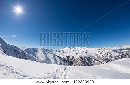 Sun Star Glowing Over Snowcapped Mountain Range, Italian Alps
