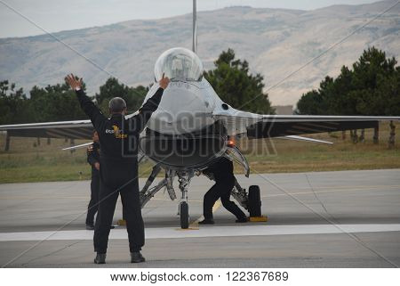 ESKISEHIR/TURKEY-SEPTEMBER 21: Turkish Air Force-TURAF's Soloturk display aircraft and crew at the Eskisehir 1st Main Jet Base during the air fest. September 21, 2014-ESKISEHIR/TURKEY