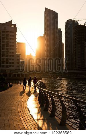 UAE DUBAI - DECEMBER 31: Skyscrapers silhuette at sunset in Dubai marina on December 31 2014. Contre jour shot
