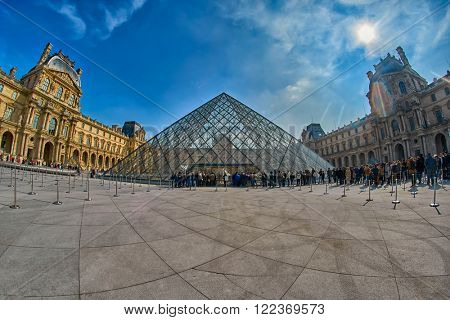 PARIS, FRANCE - 12 MARCH 2016: Tourists lining up to enter the Louvre Museum