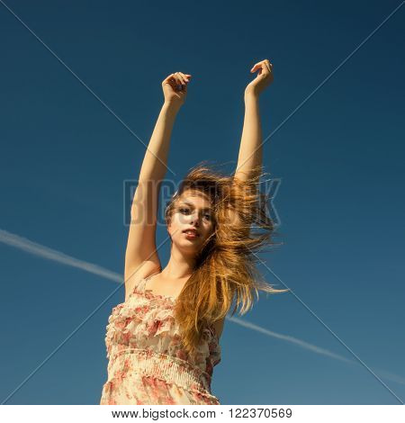 Woman enthusiastic spread her arms to the sky