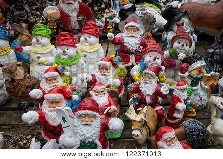 many santa claus figures christmas background - garden gnomes