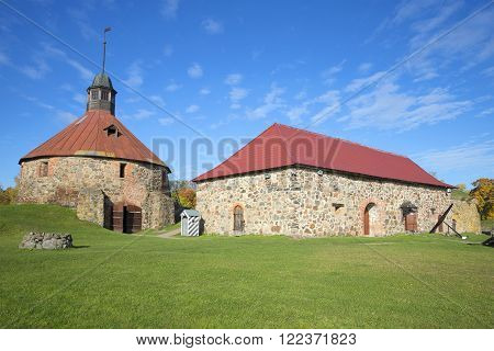 The round tower Lars Torstensson and the Old Arsenal building in the fortress Korela. Priozersk, Russia