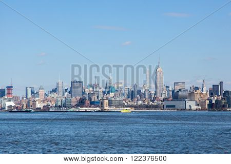 JERSEY CITY NJ - MARCH 6: A view of Midtown Manhattan featuring the Empire State Building and 432 Park as seen from Liberty State Park on March 6 2016.