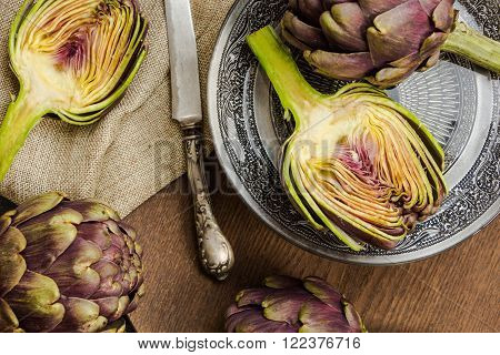 Fresh Cut Purple Artichokes In Oriental Bowl Closeup Background