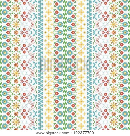 Seamless motley summer pattern. Vertical chains of flowers twining stems leaves butterflies and trifoliate clovers forming beautiful variegated ornament. Vector illustration for creative design