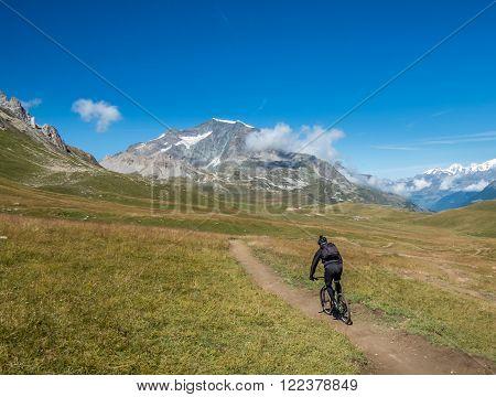 Riding mountain bicycle through some scenic mountain sceenary