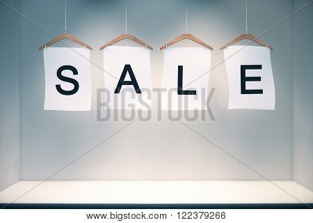 Sale Concept Labels In Empty Grey Room