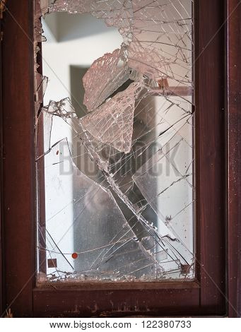 Window with broken glass for burglary attempt