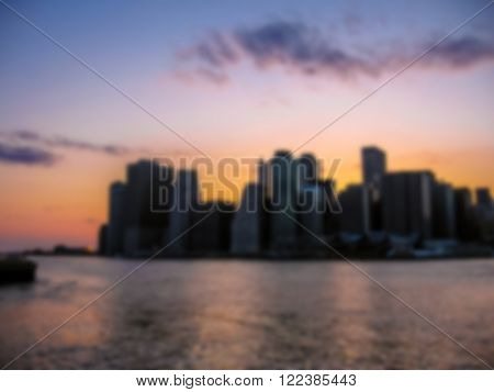 Defocused background with Manhattan Skyline with Empire State Building over Hudson River, New York City, United States. Intentionally blurred post production for bokeh effect