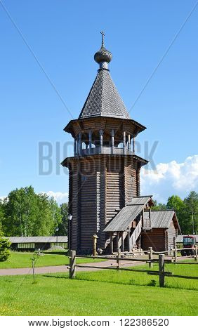Bell tower in complex Manor Bogoslovka in the style of Russian wooden architecture in the Nevsky Forest Park in St. Petersburg.