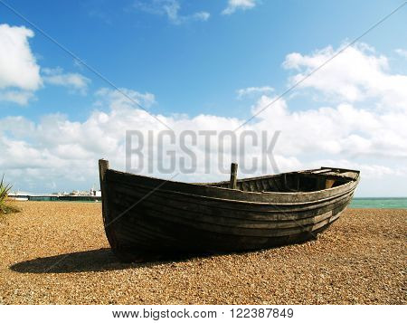 Old unusable boat on the beach in Brighton