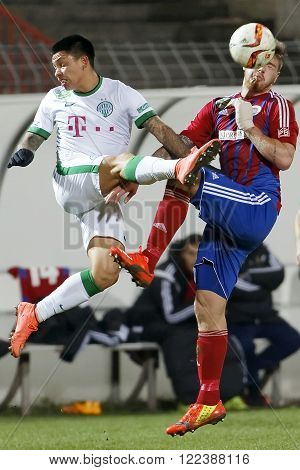 BUDAPEST HUNGARY - MARCH 19 2016: Air battle between Martin Adam of Vasas (r) and Cristian Ramirez of Ferencvaros during Vasas - Ferencvaros OTP Bank League football match at Illovszky Stadium.
