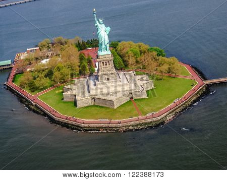 Spectacular helicopter view of Liberty Island and the famous Statue of Liberty monument symbol of New York City, United States.