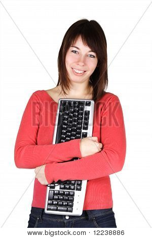 Young Beauty Woman In Red Shirt Holding Computer Keyboard And Smiling, Isolated