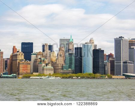 Manhattan Skyline with Empire State Building over Hudson River, New York City, United States. Seen from the ferry to Staten Island.