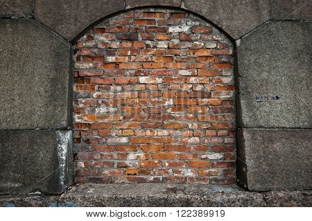 Brick closed window of an old stonewall