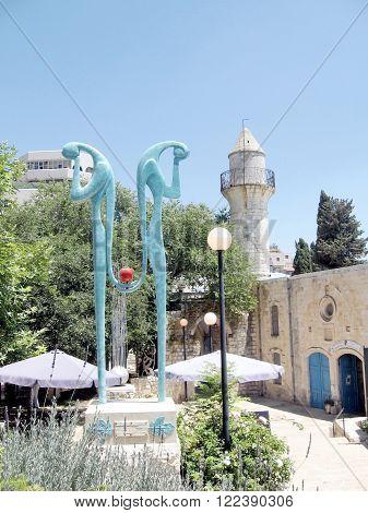 SAFED, ISRAEL - JUNE 29, 2008: The sculpture near minaret on June 29, 2008 in Old City Safed, Israel