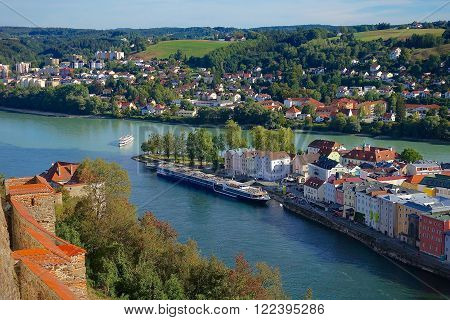 The junction of the rivers Inn and Danube in Passau Germany