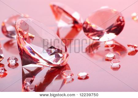 diamonds with different sizes in pink light
