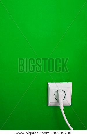 electric consumption - electric outlet on green wall
