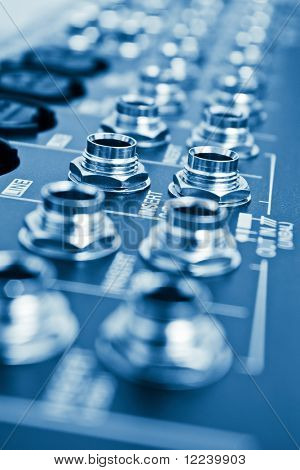 audio jacks on mixer blue toned with shallow depth of field