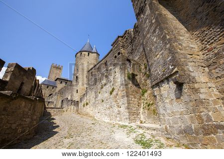 CARCASSONNE, FRANCE - JULY 20, 2013: Medieval citadel of Carcassonne. Carcassonne is in the Aude department and chief town of the Languedoc-Roussillon region in the south-west France.