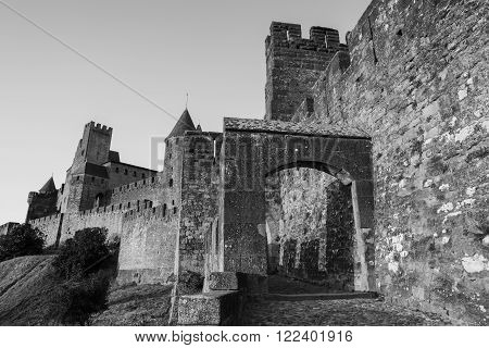Castle of Carcassonne is a medieval fortified French town in the Region of Languedoc-Roussillon, France. Black & White photo.