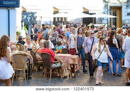 Rome Italy - August 22 2015: people walking and take drinks in the Pantheon square in Rome