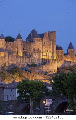 Castle of Carcassonne is a medieval fortified French town in the Region of Languedoc-Roussillon, France. Illuminated at night.