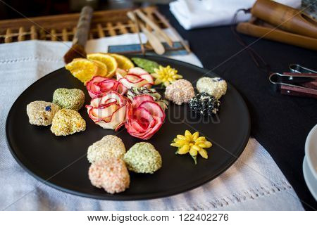 Korean sweets on a black plate tea ceremony table selective focus