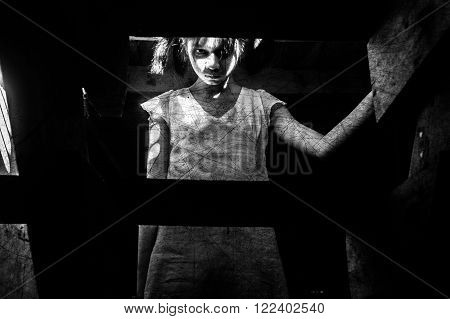 Ghost girl in haunted house staring to cameras,Mysterious girl in white dress standing on stairway in abandon house