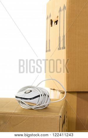 Computer mouse on moving boxes over white background - office moving or relocation concept