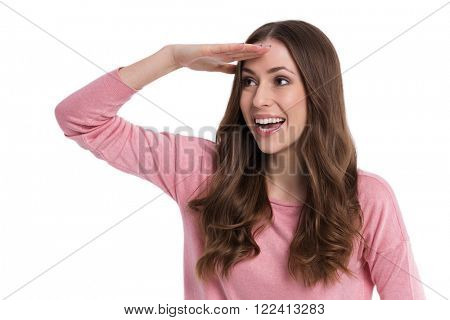 Woman with hand on forehead looking into distance