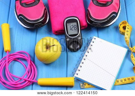 Glucose meter with result of sugar level sport shoes apple and accessories for fitness diabetes healthy and active lifestyles copy space for text on sheet of paper