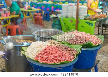 Bangkok, Thailand - April 10, 2016 : Thai exotic food in street food market. Like the charming people, exotic foods greets you on almost every corner in Thailand.