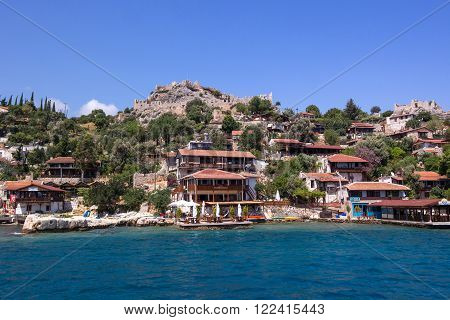 Antalya Turkey - August 28 2014: Kalekoy village on the Turkish island of Kekova. View of the castle the fortress of the Knights of Malta.