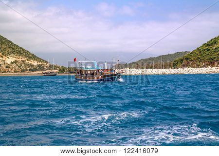 Kekova Antalya Turkey - August 26 2014: : Seascape of Kekova which is an ancient Lycian region in Antalya view of sailing boats and people swimming around on bright blue sky background.