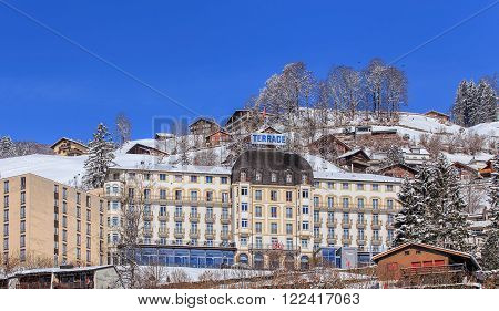 Engelberg, Switzerland - 9 March, 2016: view with residential houses and Hotel Terrace building. Engelberg is a resort town and municipality in the Swiss canton of Obwalden.