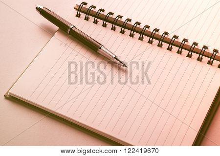 Open Notebook With Metallic Ball Pen