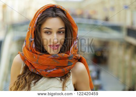 Close up portrait of a muslim young woman wearing a head scarf, indoor