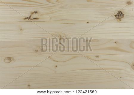 Natural glued spruce board. Wooden background for text. Detail of the structure of spruce.