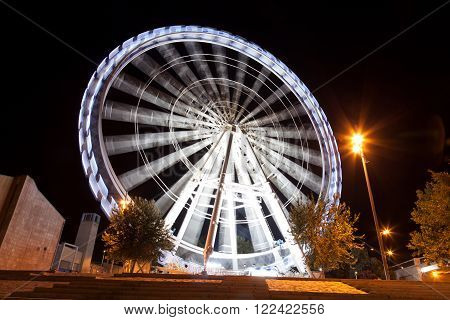 Working big wheel at night in Zaragoza Spain