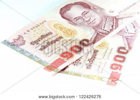 Closed up Thai banknote hundred Baht isolated on white background