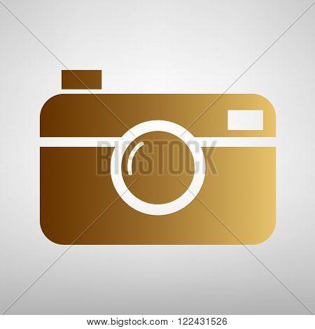 Digital photo camera icon. Flat style icon with golden gradient