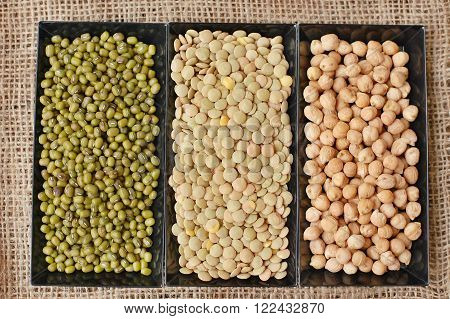 Chickpeas, Lentils, Mung Beans In Black Plate On The Gunny Cloth