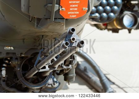 Gatling cannon on attack helicopter. Shallow DOF focus on gunpoint.