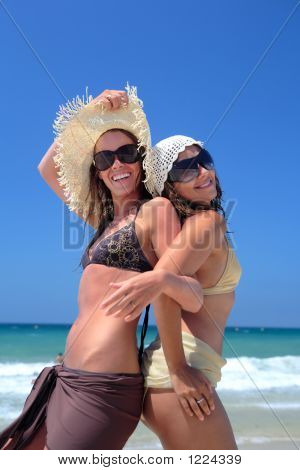 Two Sexy Young Girls Or Friends Playing On A Sunny Beach On Vaca