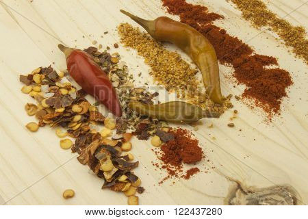 Chilies to spruce board. Hot spices, dried chilli. Spicy food.