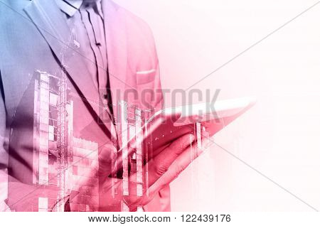 Double Exposure Of Architect Or Business Man Use Mobile Tablet With Construction Site